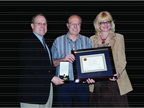 NAAA President Charlotte Pyle (right) and Frank Hackett (l) presented