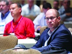 Warren Byrd, EVP of corporate development at ADESA (right), focuses on