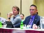 John Elizaga, director of vehicle remarketing at Emkay, Inc. (right)