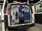 Masterack's display maximizes space inside the vehicle, with shelving, drawers, hooks, and even ladder storage inside the vehicle.