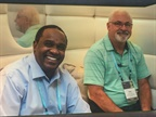 Kirk Budhai (left), fleet manager for Hearst Corp., networks at the
