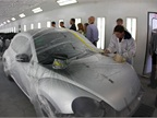 A Volkswagen Beetle is wrapped for repainting.