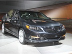 The 2014 Acura RLX offers a three-motor hybrid powertrain that includes a direct-injected V-6 gasoline engine, seven-speed dual clutch transmission with electric motor, and electrically powered all-wheel drive system.