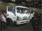 Showgoers mob the 2018 Isuzu FTR, the company's all-new entry in