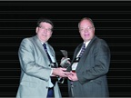 Automotive Fleet s Editor Mike Antich (right) gives Dan Kennedy (left)