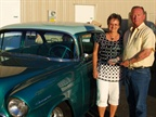 Susan and Curt Davis show off their  55 Chevy, which has been a