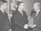 In 1963, Ed (center) accepts a plaque from Howard Pyle, president of the National Safety Council. The award is given to a publication for outstanding coverage in the field of safety. Looking on is Roy Wiley, AF's executive editor.