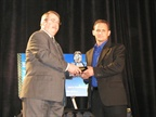 Bob Adamsky (right), Del Air Heating & Air Conditioning, accepts a