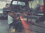 A welder in O Gara Coachworks  West Coast Plant.