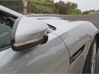 Side-view mirrors automatically retract when the vehicle is parked.