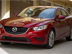 The front-wheel-drive Mazda6 (Touring trim shown) gets a mid-cycle