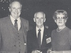George Frink (left) leasing chieftain of Chevrolet, chats with Mr. and