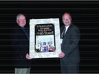 Larry Tribble, president, Southern Auto Auction (left), celebrates the