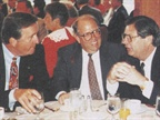 Engrossed in a lively discussion are (left to right) Doug Madeley,