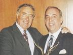 Ed Bobit (left), editor and publisher of AF, presents the 1996