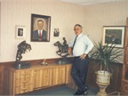Ed in his office with a portrait of his father Cyrill Bobit.