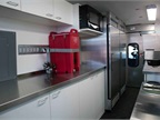 This Transit houses a custom-installed two-burner stovetop, microwave,