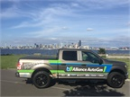 The truck cruises along the west Coast with Seattle in the background.