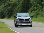 An all-new Ram 1500 powers through the roadsides of rural Tennesse.