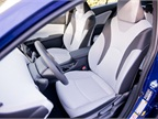 Front fabric-trimmed seats include a six-way adjustable driver s