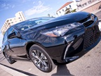 Toyota added a more prominent trapezoidal grille to the Camry s front