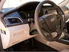 The interior offers a heated steering wheel, ventilated heated/cooling