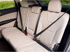 Rear bench seating accommodates three passengers.