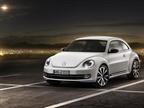 Volkswagen s 2012 New Beetle features a lower roofline.