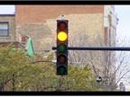 Chicago's Shorter Yellow Lights Bolster Red-Light Ticketing